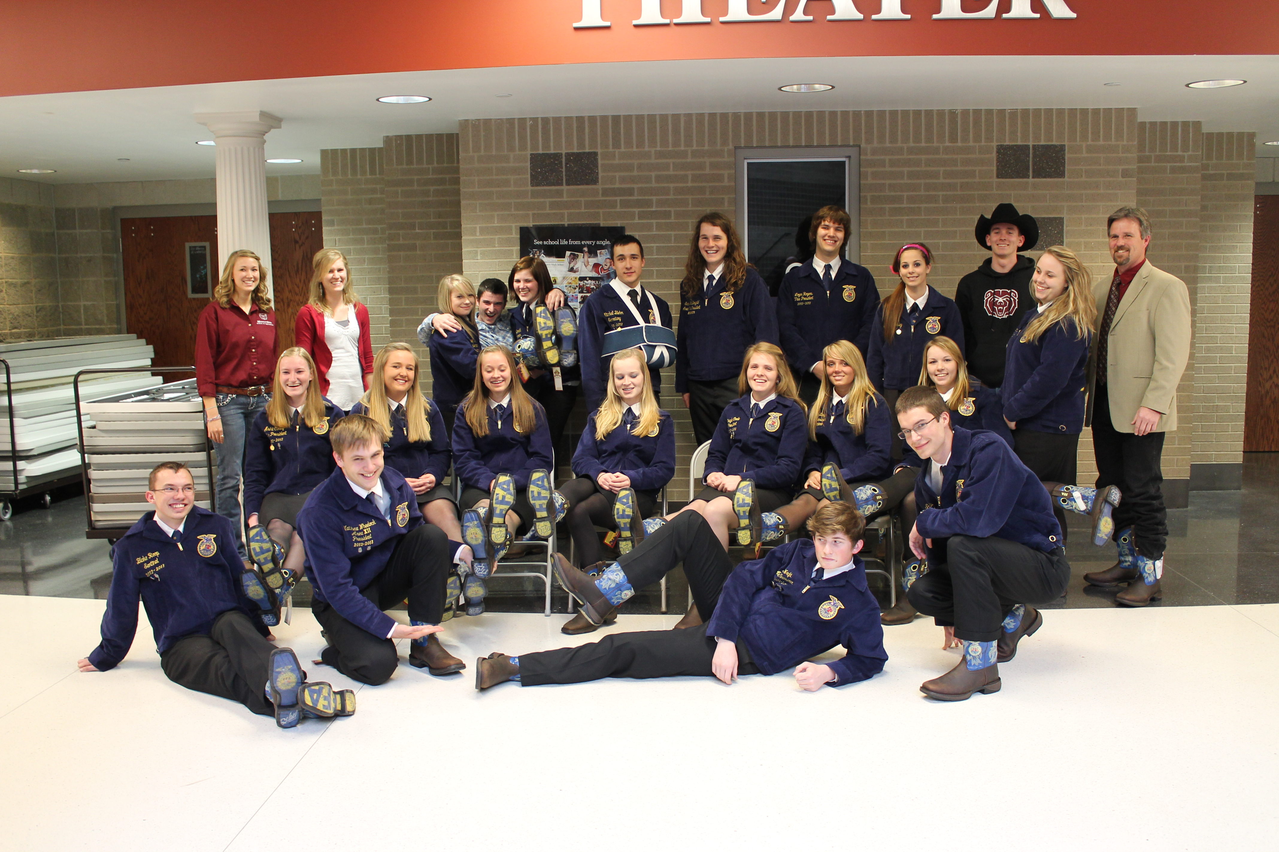 FFA Area Officers from Areas 10 and 12 show off their new boots with with student leaders from the William H. Darr School of Agriculture.