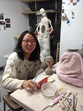 Alice (Lin, Yi-huei) working in MSU Brick City ceramics studios