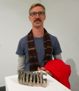 Craig Hartenberger with his piece in the NCECA Juried Exhibition.