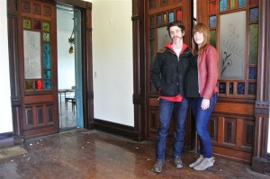 Zachary Tate and Leah Schroeder stand inside the old white house on the corner of S. Fifth Street and E. Madison Street in Goshen March 11, 2015. The couple is buying the house to turn it into Goshen Youth Arts