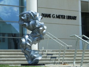 Instructor's sculpture on display at library