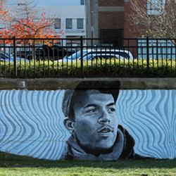 Student paints mural across from Brick City