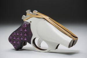 "Johanna Typaldos. ""Rubber Band Gun."" Copper, aluminum, purple heart wood, plastic beads, powder coat"