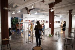 students observing art installation