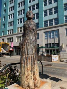 Photo of a wooden sculpture of a figure (Photo Credit: Sculpture Walk Springfield)