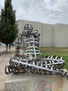 Photo of a metal sculpture of a seated woman (Photo Credit: Sculpture Walk Springfield)