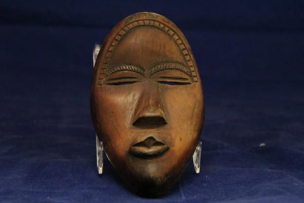 Miniature Deangle Mask Dan culture 20th century Wood and pigment, L. 7 cm x W. 2.5 cm x H. 12 cm BFPC collection #2010.010