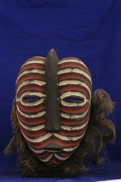 Kifwebe Mask Luba-Songye culture 20th century Wood, raffia, and pigment, L. 36 cm x W. 20 cm x H. 38.5 cm Mace collection #TH115