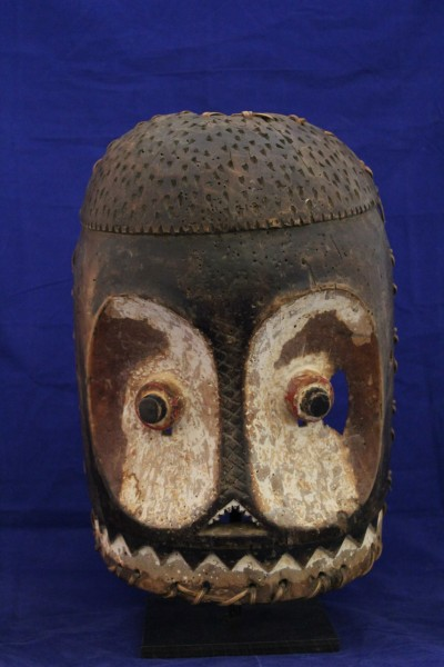 Echawokaba Mask Bembe culture 20th century Wood, raffia, and pigment, L. 23 cm x W. 15 cm x H. 38 cm Mace collection #TH023