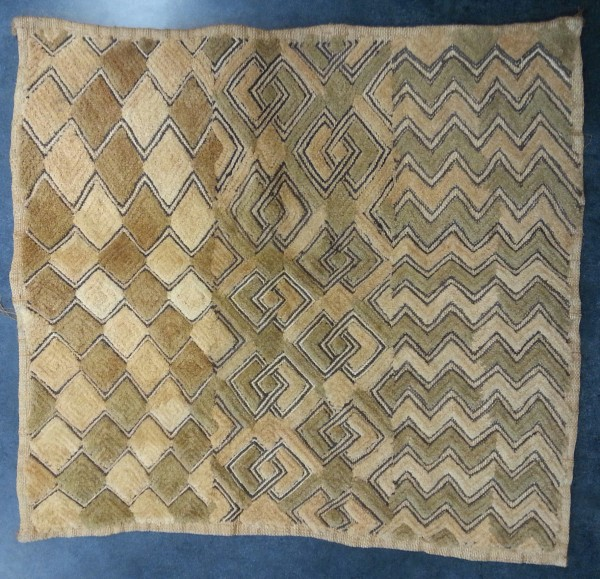 Kasai Velvet with Three Sets of Geometric Designs Kuba culture Late 20th to early 21st century Raffia and pigment, L. 56 cm x W. 3 mm x H. 56 cm BFPC collection #2013.2
