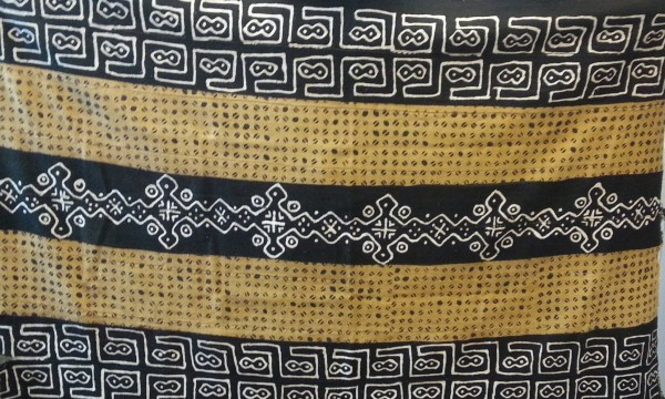 Bogolanfini Cloth with Brown Oval Pattern and White Geometric Patterns Bamana culture Late 20th to early 21st century Cotton and pigment, L. 107 cm x W. 2 mm x H. 173 cm BFPC collection #2013.5