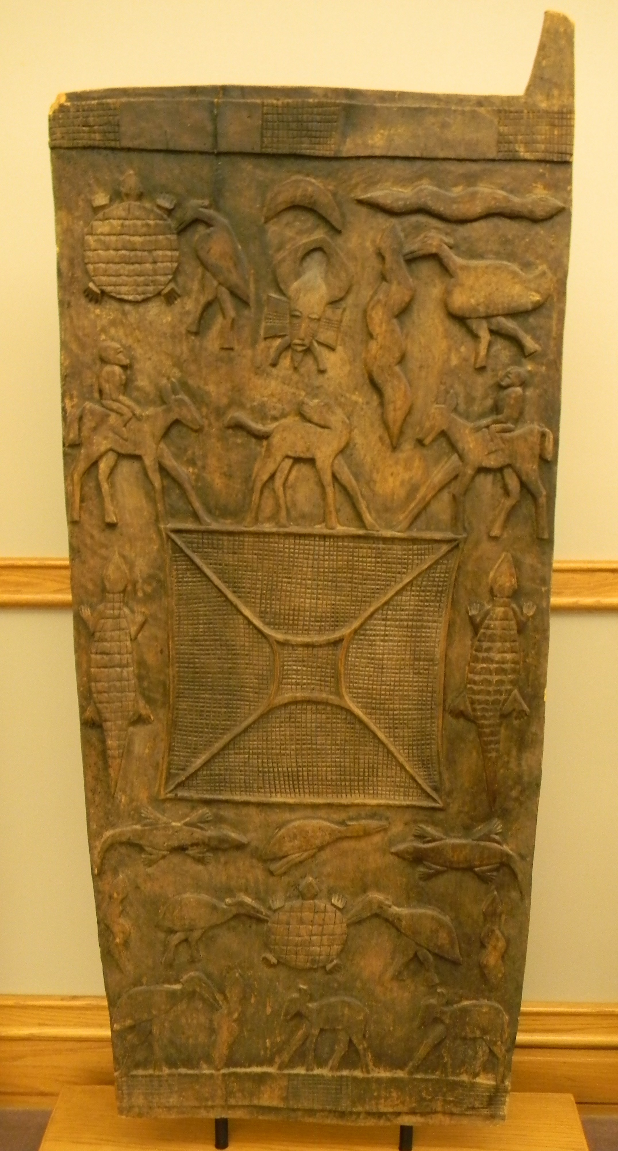 Large Carved Sanctuary Door with Multiple Animal Motifs Senufo culture 20th century Wood and pigment & Senufo Wooden Doors Researched by Andrew Pilkenton