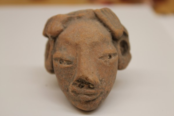 Head of a Figurine with Earspools and Scalloped Hairline Tlatilco culture 1500 B.C.E.-250 C.E. Ceramic, L. 5.5 cm x W. 1.6 cm x H. 6.5 cm Ralph Foster Museum collection #76.869.1