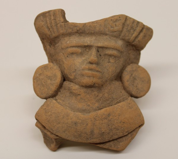 Head of a Figurine with Headdress and Large Earspools Early Teotihuacano culture 1500 B.C.E.-250 C.E. Ceramic, L. 4.6 cm x W. 2.9 cm x H. 5.5 cm Ralph Foster Museum collection #76.869.6