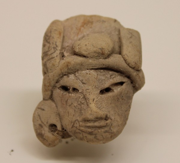 Head of a Figurine with Three-Part Headdress Early Teotihuacano culture 1500 B.C.E.-250 C.E. Ceramic, L. 2.7 cm x W. 2 cm x H. 3.5 cm Ralph Foster Museum collection #76.790.125