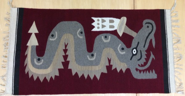 Red Rug with Gray Coatl Motif Zapotec culture 20th century Wool and pigments, L. 1.56 m x W. 8 mm x H. 72.3 cm Sparkman collection #2013.22