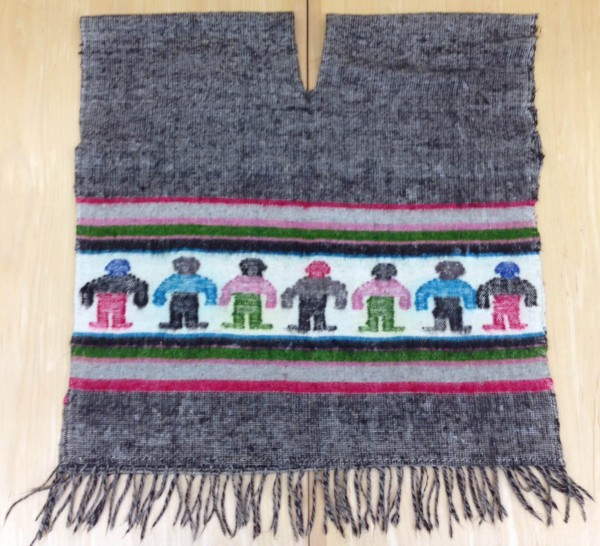 Grey Sarape with Colorful Frontal Images and Fringe Maya culture 20th century Wool and pigments, L. 77.6 cm x W. 2.2 cm x H. 90.6 cm Sparkman collection #2013.23