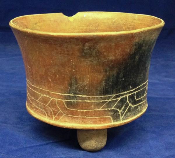 Thin Orangeware Tripod Vessel with Incised Line Designs Post-Classic Maya culture 900-1521 C.E. Ceramic, L. 14 cm x W. 14 cm x H. 12 cm Ralph Foster Museum collection #90.40.1