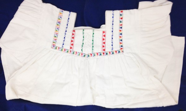 Child's Dress with Heart Motif Maya culture Early 1970s White cotton and colored embroidery floss, L. 76 cm x W. 8 mm x H. 68 cm Edie Ballweg collection #1972.44