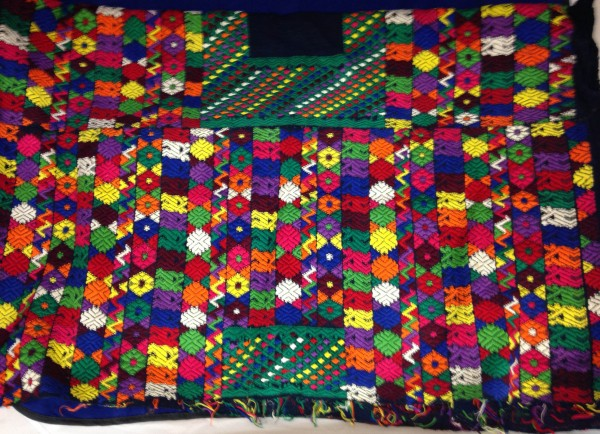 Colorful Huipil with Unfinished Neckline from Tactic, Guatemala Pocomchí Maya culture Early 1970s Cotton and pigments, L. 1 m x W. 2 mm x H. 83 cm Edie Ballweg collection #1972.12
