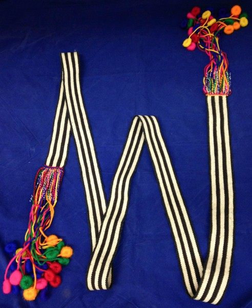 Black and White Faja with Tassels from Sumpango Chichicastenango Maya culture Early 1970s Maguey fiber, wool, synthetic fibers, and pigments, L. 2.37 m x W. 5 cm x H. 8 cm Edie Ballweg collection #1972.42