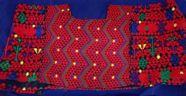 Red, Blue, and Green Huipil from Tactic, Guatemala Pocomchí Maya culture Early 1970s Cotton and pigments, L. 1 m x W. 8 mm x H. 30.6 cm Edie Ballweg collection #1972.82