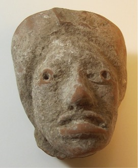 White-Slipped Figurine Head Olmec culture 1500 B.C.E.-250 C.E. Ceramic, L. 4.5 cm x W. 5 cm x H. 6 cm Ralph Foster Museum collection #76.790.106