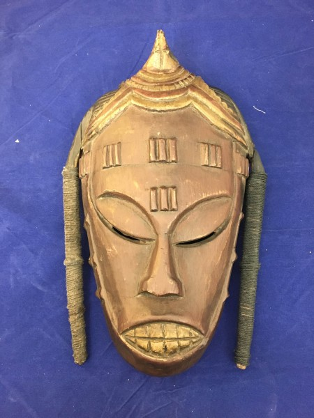 Mukudj Tourist-Trade Mask Punu culture 20th century Wood, pigment, and cord, L. 16 cm × W. 7.5 cm × H. 31 cm BFPC collection #2008.22