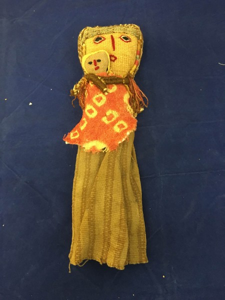Chancay Doll of a Mother and Child with a Pink Blanket Andean Mestizo culture (doll) and Chancay culture (textiles) 20th century (doll) and 1000-1460 CE (textiles) Cotton, alpaca wool, plant fibers, and natural dyes, L. 6.7 cm x W. 4.5 cm x H. 26.6 cm BFPC collection #2011.13
