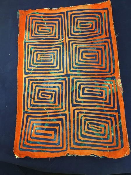 Spiral Design Blue and Orange Mola Kuna culture 20th century Cloth and dye pigments, L. 66 cm x W. 5 mm x H. 38 cm BFPC collection #2012.6