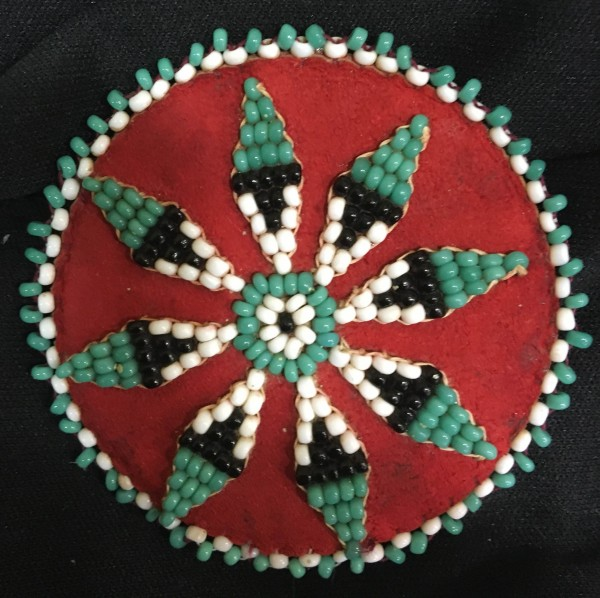 Green and White Flower Beaded Rosette Apache culture (?) 20th century Glass beads, cloth, and leather, L. 6.5 cm x W. 5 mm x H. 6 cm Ralph Foster Museum collection #90.42.27