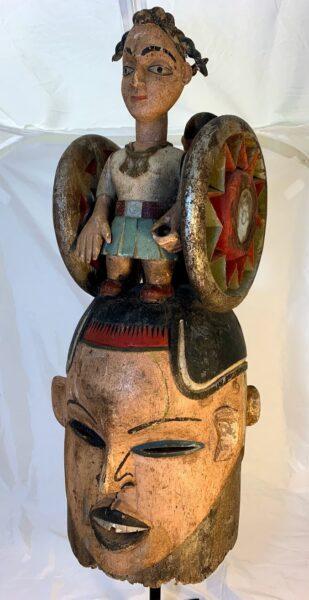 Image of the Janus Helmet Mask with Modern Female Figure on top