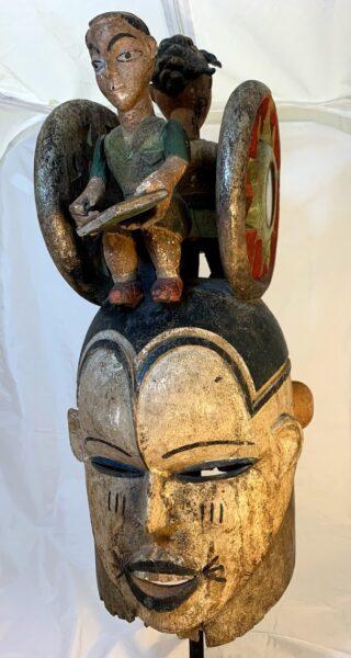 Image of the Janus Helmet Mask with Modern Male Figure on top
