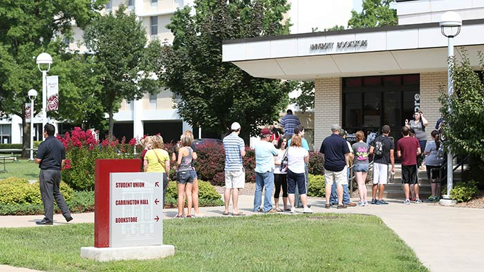 People waiting in line in front of the Missouri State University book store