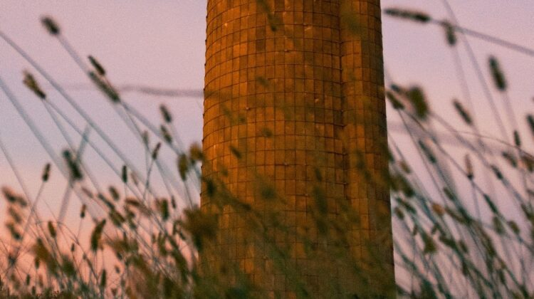 Gray brick silo in the morning light