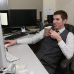 Man at his desk using a computer