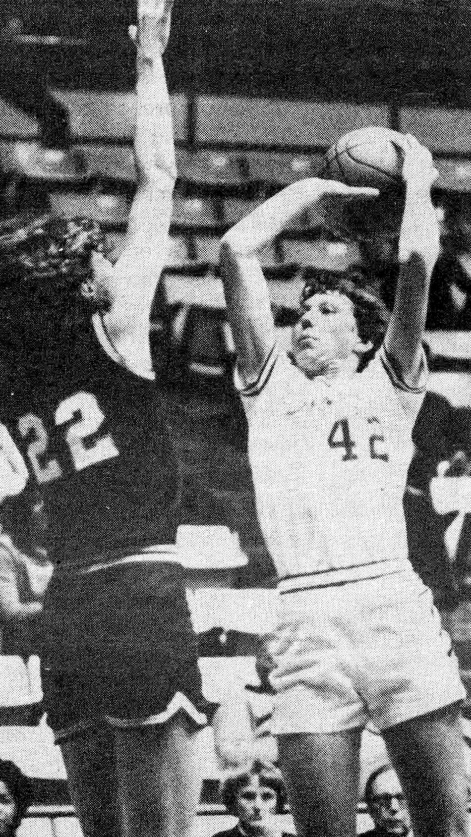 Newspaper photo of Jeanette Tendai shooting a basketball