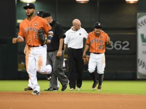 Rex Jones helping injured player off the field.