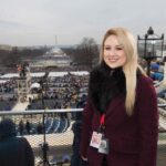 Brittany Donnellan stands in front of inauguration stage