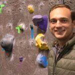 Dalton Breeding in front of climbing wall
