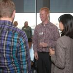 alumni and students talking at networking event