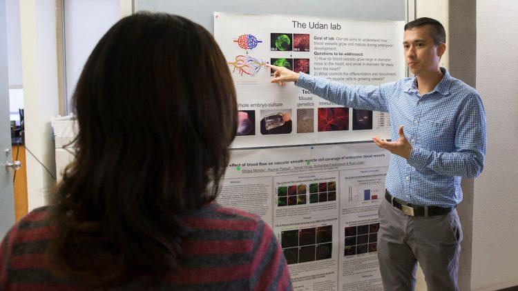 Udan discussing his lab