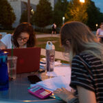 students at bench studying