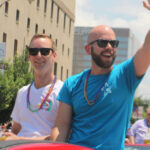 Andrew Shaughnessey rides in Pride parade
