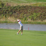 Sam Holmes golfing