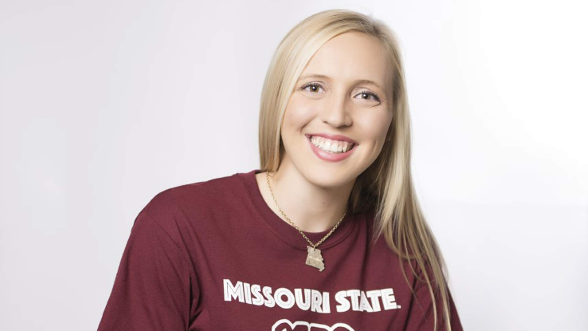 Hannah Harrill wearing Missouri State T-shirt and smiling at camera.