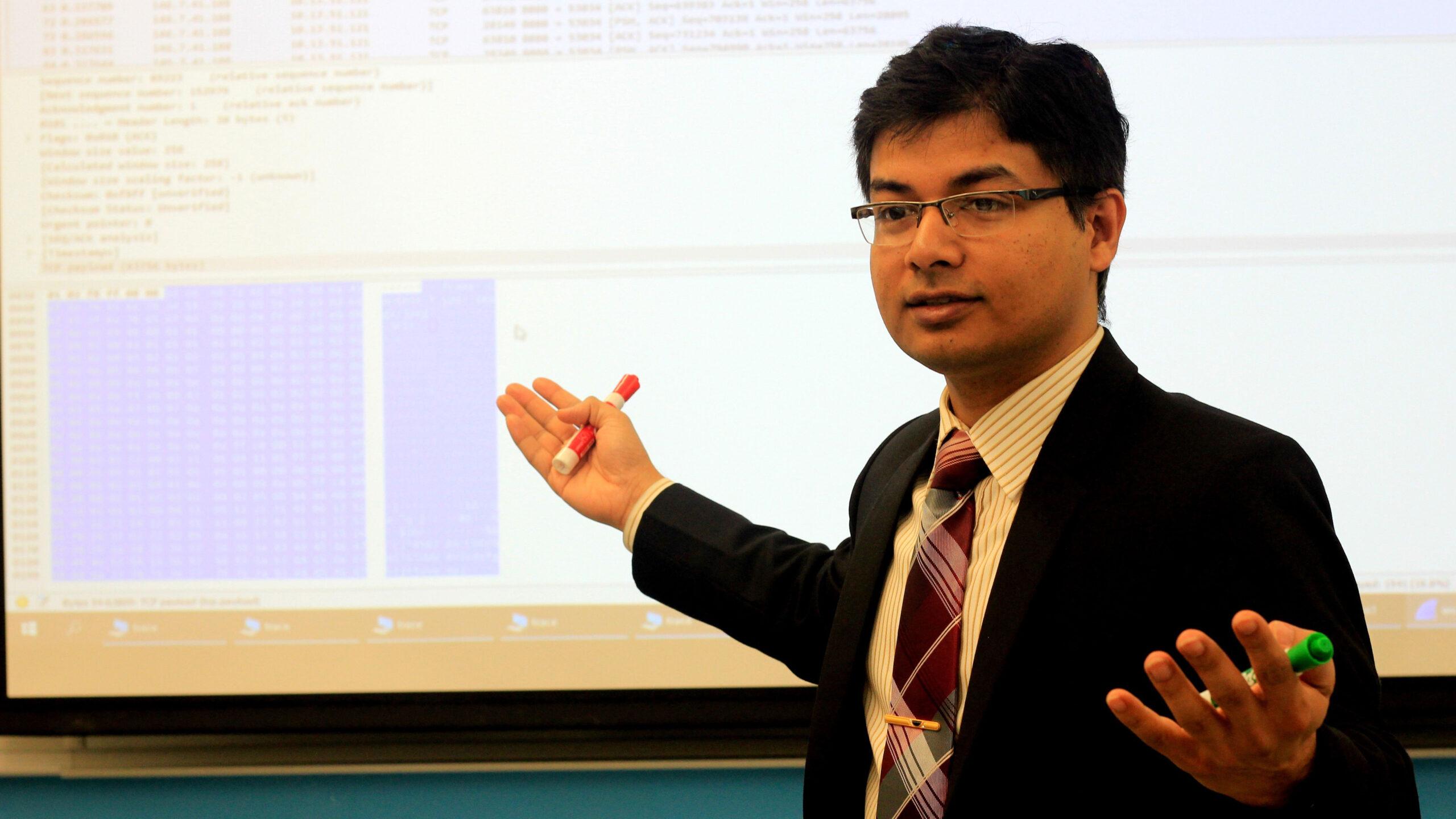 Iqbal teaching his class