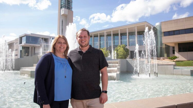 Ethan and Jayma in front of the John Q. Hammons Fountain on the Missouri State campus
