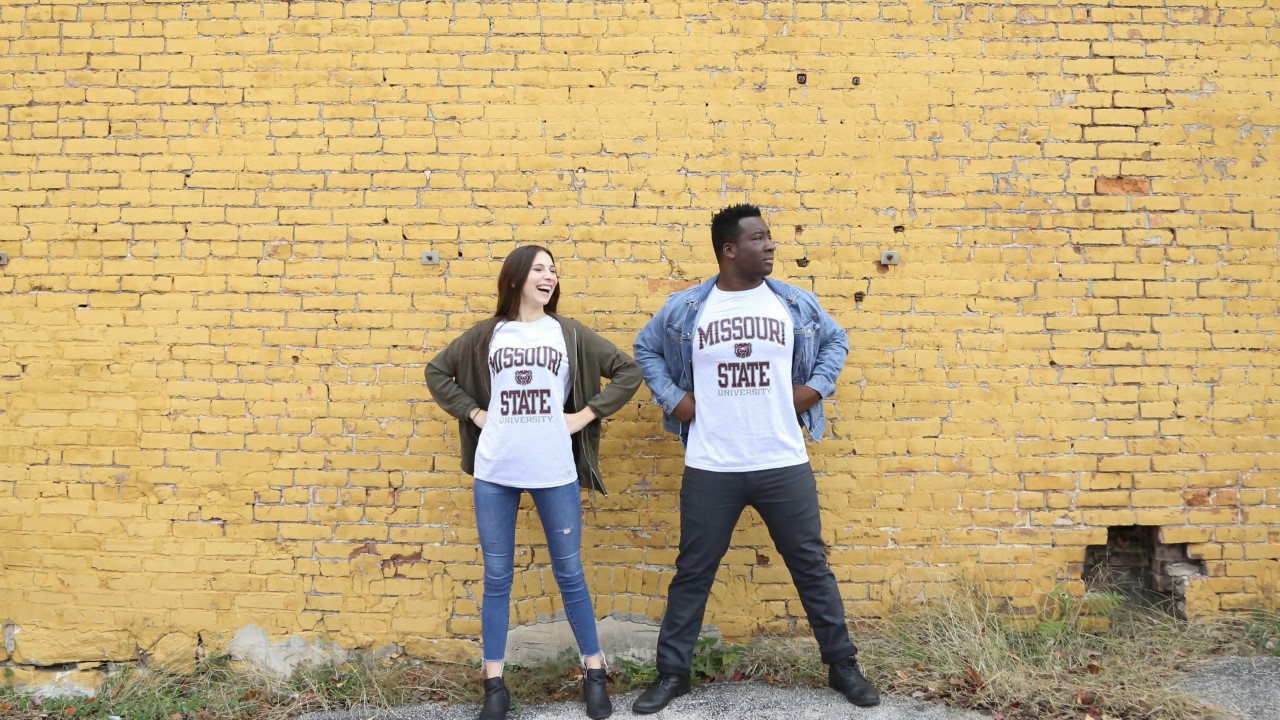 Nii and Rachel Abrahams pose for an engagement photo in BearWear