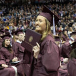 missouri state graduate smiling with diploma